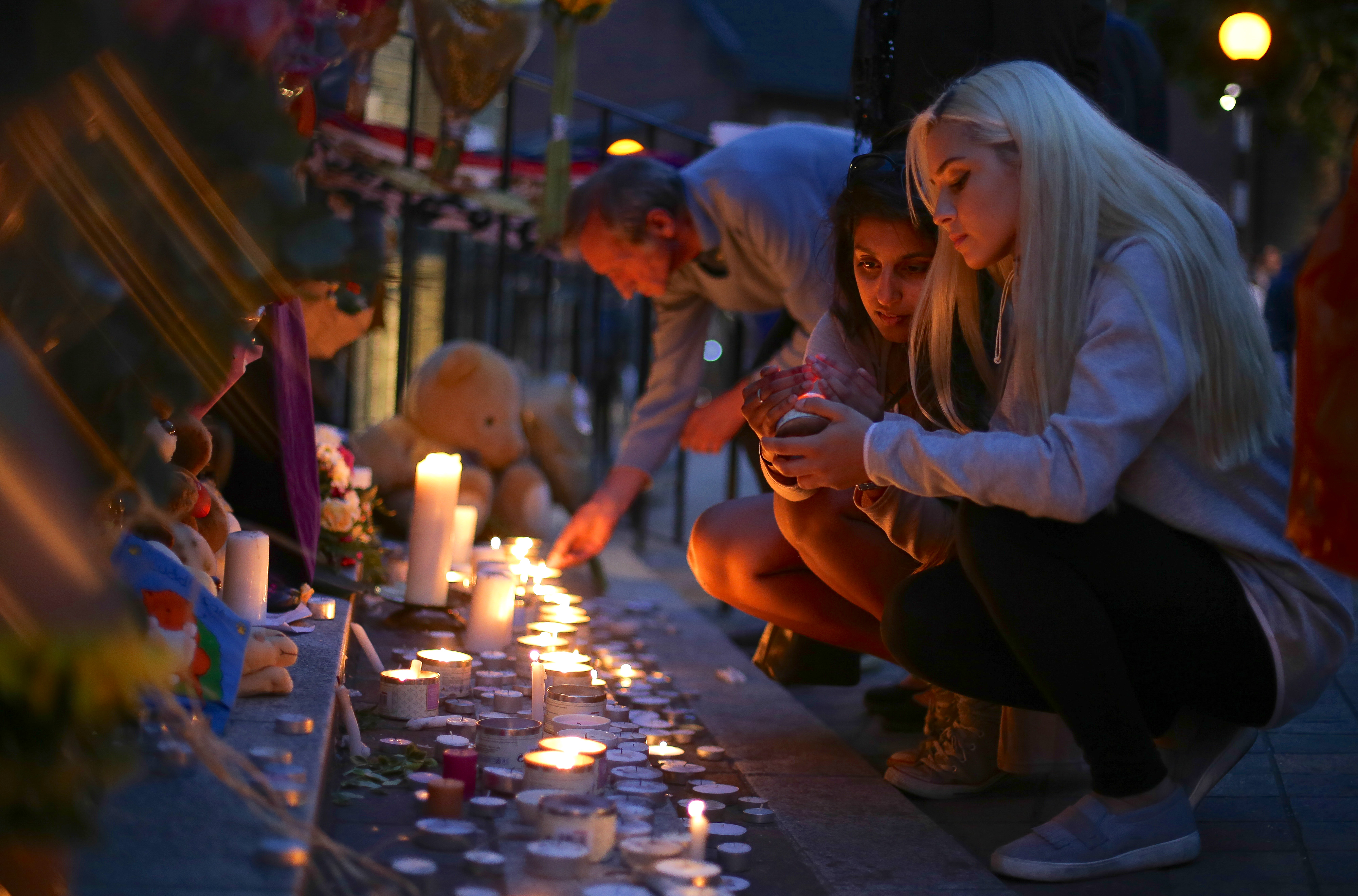 People light candles for a memorial outside Notting hill Methodist Church following the blaze at Grenfell Tower, a residential tower block in west London on June 15.  (DANIEL LEAL-OLIVAS/AFP/Getty Images)