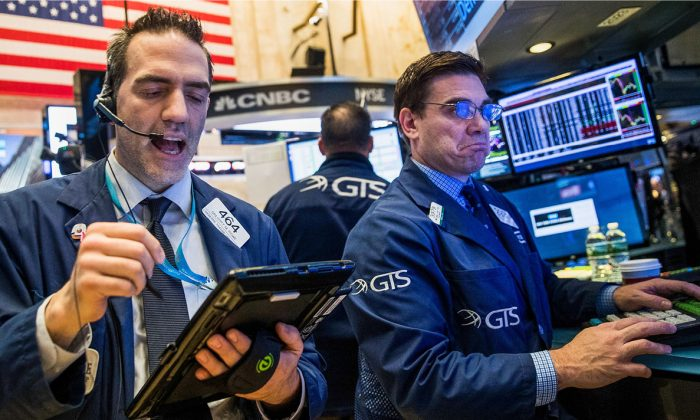 Traders on the floor of the New York Stock Exchange on April 7. (DREW ANGERER/GETTY IMAGES)