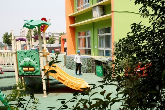 An investigator walks at the scene of an explosion inside a kindergarten in Fengxian County of Xuzhou in Jiangsu Province, China June 16, 2017. (Reuters/Aly Song)