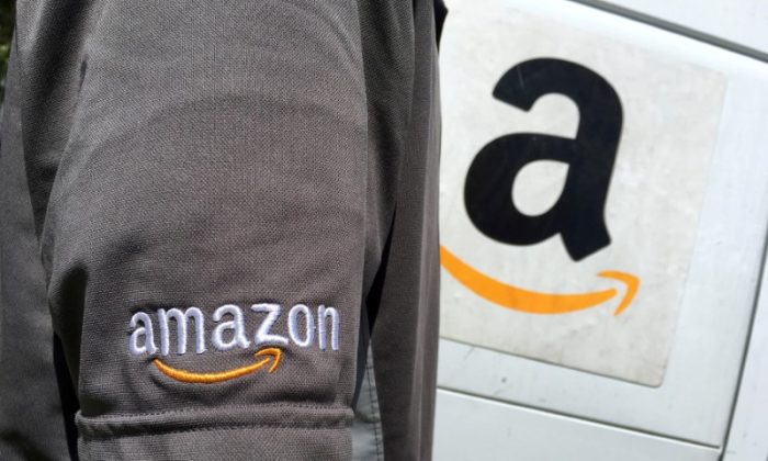 An Amazon.com Inc driver stands next to an Amazon delivery truck in Los Angeles, California on May 21, 2016. (Reuters/Lucy Nicholson)