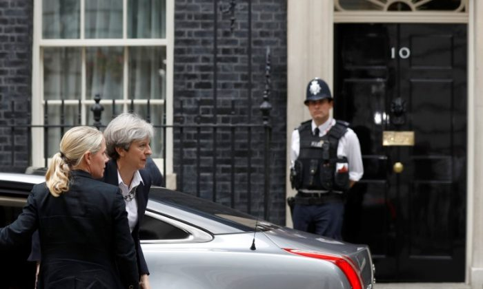 Britain's Prime Minister, Theresa May, arrives at 10 Downing Street, in central London, Britain on June 16, 2017. (REUTERS/Peter Nicholls)