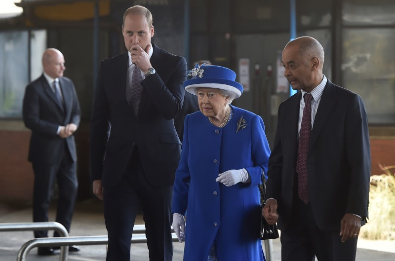 Britain's Queen Elizabeth and Prince William visit the general scene of the fire that destroyed the Grenfell Tower block, in north Kensington, West London, Britain on June 16, 2017.  (REUTERS/Hannah McKay)