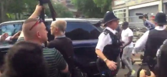 British Prime Minister Theresa May is barracked while she is bundled into her car, as she visits an emergency centre close to the scene of the Grenfell Tower fire, in north Kensington, West London, Britain, in this picture filmed by 5 News producer Rachel Lucas and obtained on June 16, 2017 on social media.  (Social media via REUTERS/Courtesy ÒRACHEL LUCAS / 5 NEWSÓ)