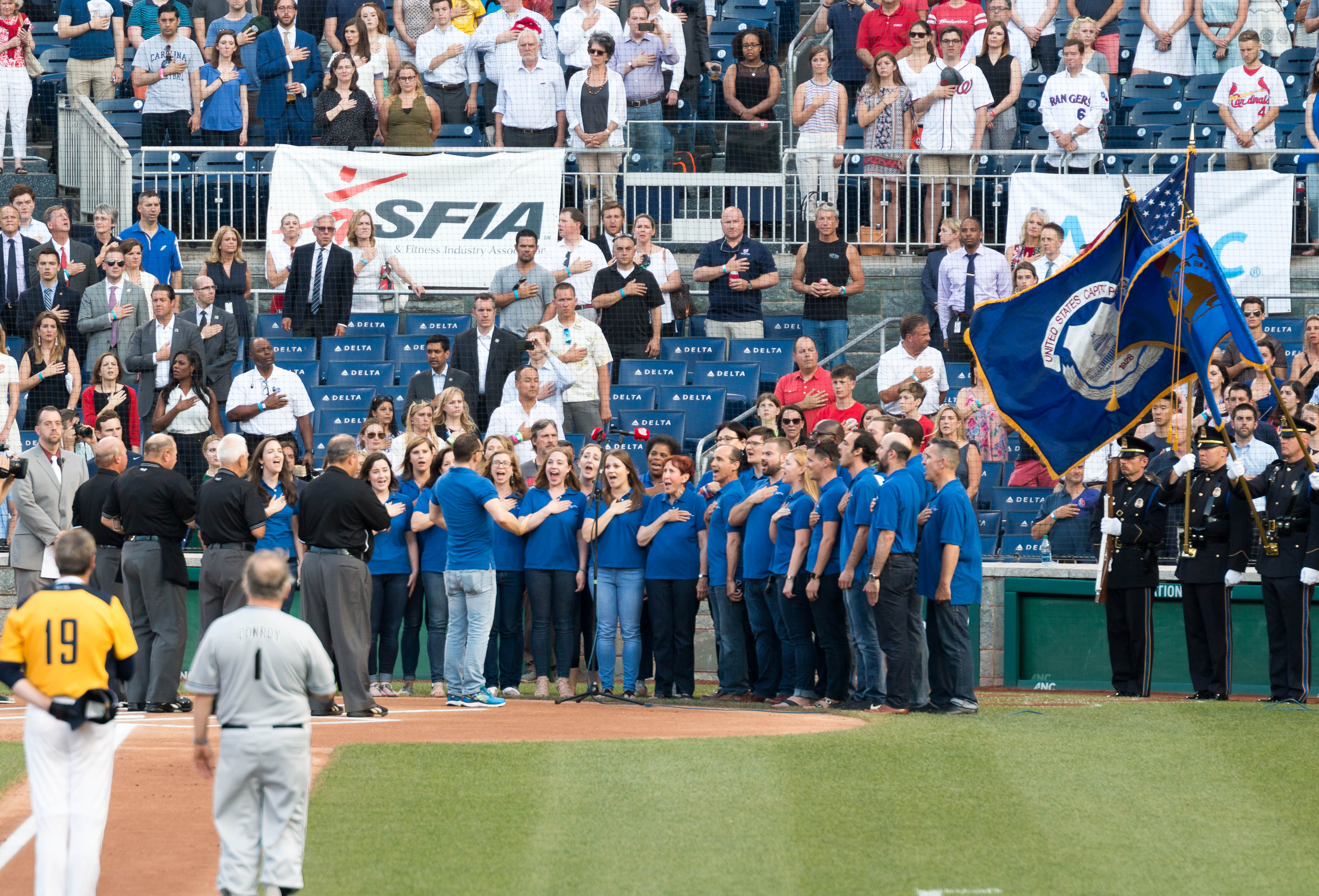 Singing of the national anthem before the start of the Congressional Baseball Game on Thursday. (Paul Huang)
