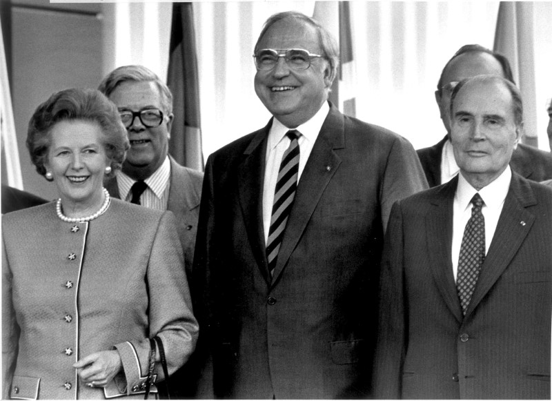 German Chancellor Helmut Kohl stands with Britain's Prime Minister Margaret Thatcher (L), Britain's Foreign Secretary Geoffrey Howe (back L) and France's President Francois Mitterrand (R) during a summit of the European Community in Hanover  on June 27, 1988. (REUTERS/Michael Urban)