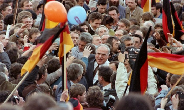 West German Chancellor Helmut Kohl moves through a crowd of supporters February 20, 1990 during his first appearance as part of the East German election campaign in Erfurt, East Germany. (REUTERS/Reinhard Krause)