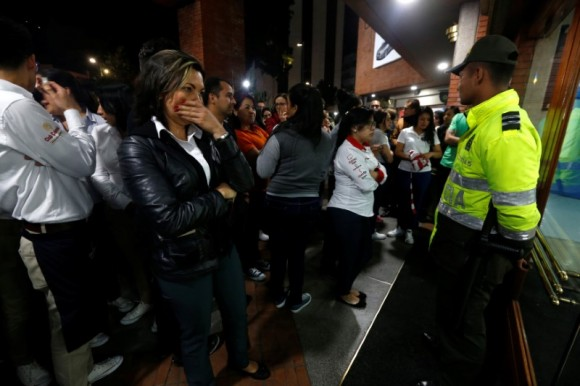 People stand outside the Andino shopping center after an explosive device detonated in a restroom, in Bogota, Colombia June 17, 2017. (Reuters/Jaime Saldarriaga)