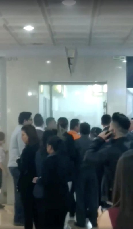 People are seen inside a shopping center after a blast took place, in Bogota, Colombia, June 17, 2017 in this still image from video obtained from social media.  (Juan Dario via Reuters)