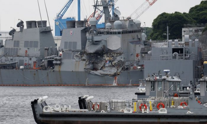 The Arleigh Burke-class guided-missile destroyer USS Fitzgerald, damaged by colliding with a Philippine-flagged merchant vessel, is seen at the U.S. naval base in Yokosuka, Japan June 18, 2017. (Reuters/Toru Hanai)