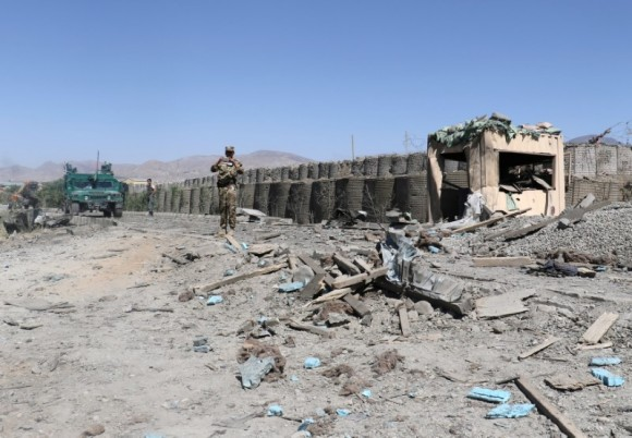 Afghan security forces inspect the aftermath of a suicide bomb blast in Gardez, Paktia Province, Afghanistan June 18, 2017. (Reuters/Samiullah Peiwand)