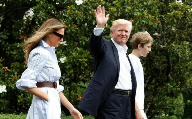 President Donald Trump, his wife Melania Trump, and son Baron Trump walk out of the White House on June 17 before their departure to Camp David for Father's Day weekend. (Yuri Gripas/Reuters)