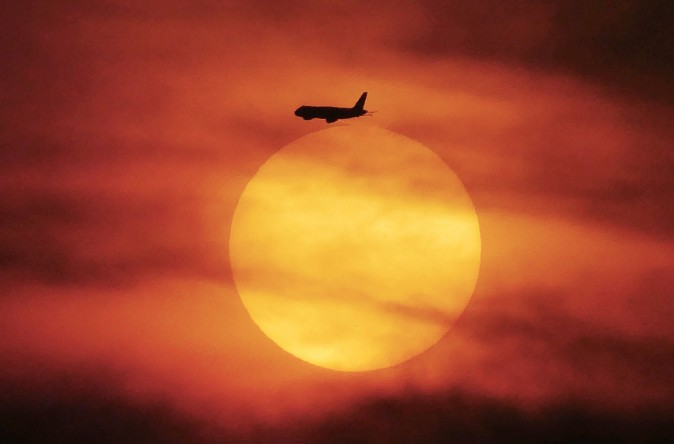 A plane flies during sunset near Jakarta, Indonesia, on June 18, 2017. (BAY ISMOYO/AFP/Getty Images)