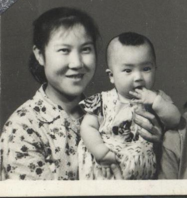 Jennifer's mother holding one-year-old Jennifer. In the same year this photo was taken, Jennifer's father was publicly denounced as a
