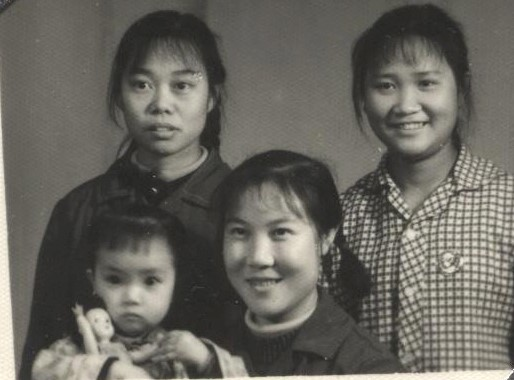 Jennifer's mother, her two friends and two-year-old Jennifer. As the first child in the family, Jennifer enjoyed some