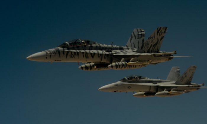 Two U.S. Marine Corps F-18 Super Hornets flying on May 31, 2017. (U.S. Air Force/Staff Sgt. Michael Battles/Handout/File Photo via Reuters)