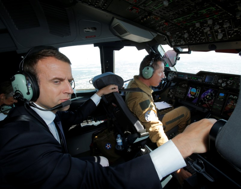 French President Emmanuel Macron sits in the cockpit of an Airbus A400M turboprop transport plane before taking off from Villacoublay military airbase near Paris, France on June 19, 2017. (REUTERS/Michel Euler/Pool)
