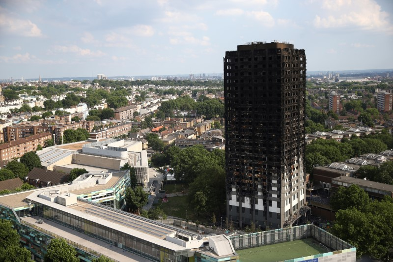 The burnt out remains of the Grenfell apartment tower are seen in North Kensington, London, Britain on June 18, 2017. (REUTERS/Neil Hall)