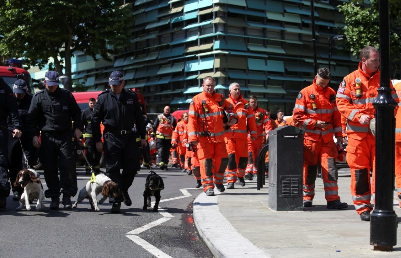 Members of the emergency services arrive to attend a minute's silence for the victims of the Grenfell Tower fire near the site of the blaze in North Kensington, London, Britain on June 19, 2017. (REUTERS/Marko Djurica)