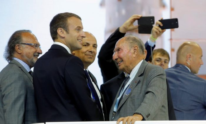 French President Emmanuel Macron (2nd L) talks with Dassault Aviation CEO Eric Trappier (C) in front of Serge Dassault (2nd R), Chairman and CEO of Dassault Group, during a visit at the Paris Air Show in Le Bourget, north of Paris on June 19, 2017. (Michel Euler/Pool/Reuters)