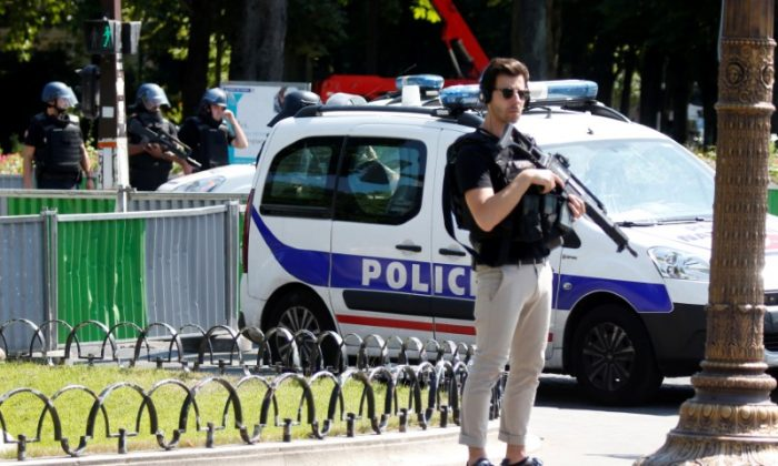 French police secure the area on the Champs Elysees avenue after an incident in Paris, France, June 19, 2017. (Charles Platiau/Reuters)