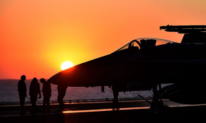 An F/A-18E Super Hornet taxis on the US navy's super carrier USS Dwight D. Eisenhower (CVN-69) ('Ike') in the Mediterranean Sea on July 6, 2016. (Alberto Pizzoli/AFP/Getty Images)