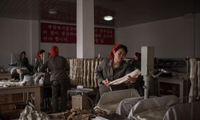 A worker processes silk at the Kim Jong Suk Silk Mill in Pyongyang, North Korea on February 21, 2017.  Ed Jones/AFP/Getty Images