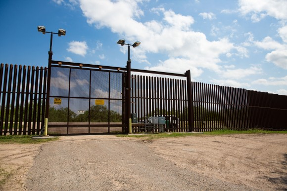A portion of the steel border fence with a gate near Noelia Guerra's house in Brownsville, Texas, on June 1, 2017. (Benjamin Chasteen/The Epoch Times)