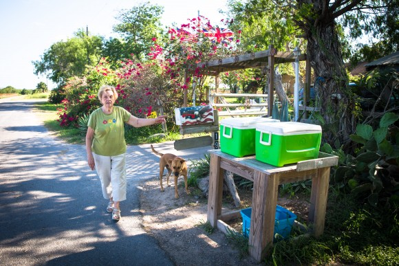 """Pamela Taylor leaves coolers with ice and drinks next to her mailbox for Border Patrol, illegal immigrants, and """"anyone else who is thirsty,"""" in Brownsville, Texas, on June 1, 2017. (Benjamin Chasteen/The Epoch Times)"""