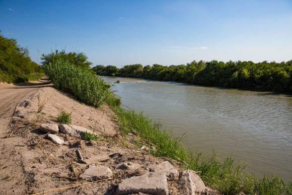 The Rio Grande behind Pamela Taylor's house in Brownsville, Texas, on June 1, 2017. Illegal immigrants must cross Taylor's property to get to the border fence. (Benjamin Chasteen/The Epoch Times)