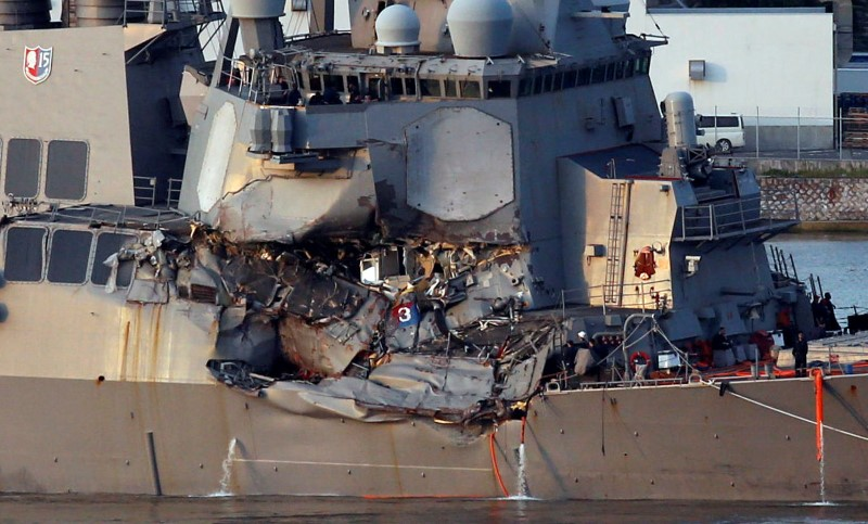 The Arleigh Burke-class guided-missile destroyer USS Fitzgerald, damaged by colliding with a Philippine-flagged merchant vessel, is towed into the U.S. naval base in Yokosuka, south of Tokyo, Japan on June 17, 2017. (REUTERS/Toru Hanai)