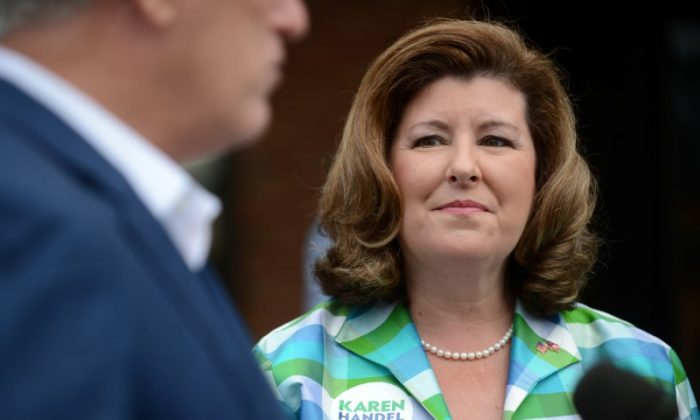 Republican candidate Karen Handel listens to House Majority Leader Kevin McCarthy (R-CA) speak to the media as she campaigns for Georgia's 6th Congressional District special election outside Bagel Boys Cafe in Alpharetta, Georgia, U.S.,  June 19, 2017. (Bita Honarvar/Reuters)