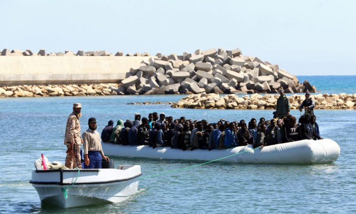 Illegal migrants from Africa arrive on shore after being rescued by Libyan coast guards rescued at sea, off the coastal town of Guarabouli, 36 miles east of the capital Tripoli on May 18, 2017. (MAHMUD TURKIA/AFP/Getty Images)