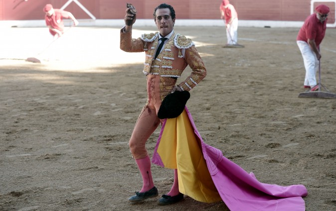 Spanish matador Ivan Fandino holds the ear of a Baltasar Iban bull during a bullfight at Aire sur Adour arena southwestern France, on June 17, 2017.  / AFP PHOTO / IROZ GAIZKA        (Photo credit should read IROZ GAIZKA/AFP/Getty Images)