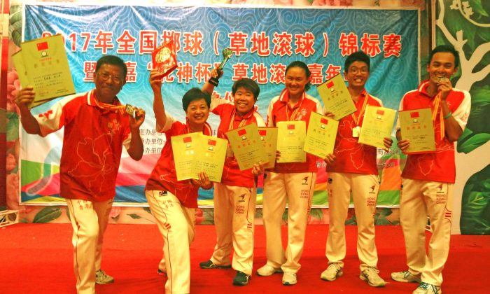 PRIDE OF HONG KONG – The Hong Kong lawn bowls team proudly displays the three trophies they won at the 2017 Chinese National Lawn Bowls Championship in Henan. Team members include (L-R) Li Ming Sum, Camilla Leung, Vivian Yip, Helen Cheung, James Po and Adrian Yau. (James Keung)