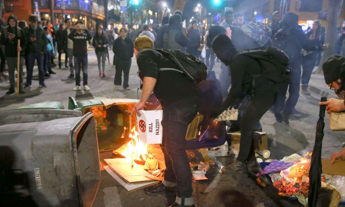 People burn trash in the street in Berkeley, California, on Feb. 1, 2017, during a violent protest over a scheduled speech by far-right commentator Milo Yiannopoulos at the University of California, Berkeley. The speech was cancelled after massive riots broke out, causing $100,000 in damage. (Elijah Nouvelage/Getty Images)