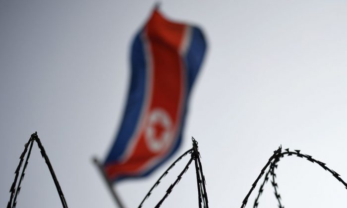 The North Korean flag is seen flying in backdrop of barbed wire at the North Korean embassy in Kuala Lumpur on March 11, 2017. (Manan Vatsyayana/AFP/Getty Images)