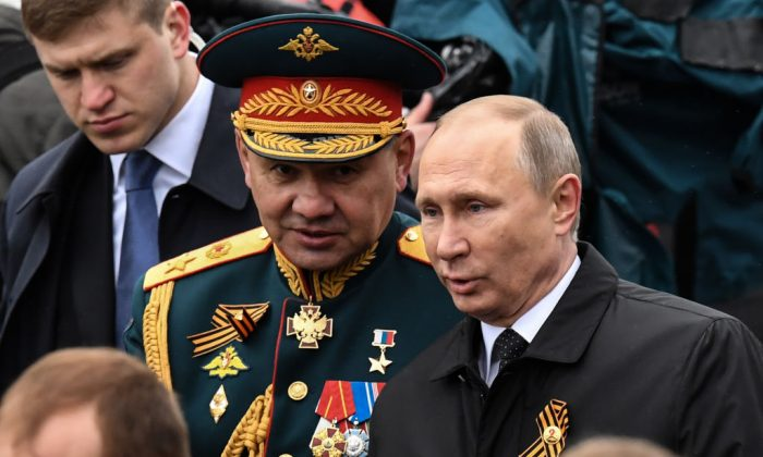 Russian President Vladimir Putin (R) and Defence Minister Sergei Shoigu walk on Red Square after the Victory Day military parade in Moscow on May 9, 2017. (KIRILL KUDRYAVTSEV/AFP/Getty Images)