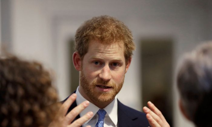 Britain's Prince Harry speaks to people during his visit to Chatham House, the Royal Institute of International Affairs in London, England on June 15, 2017. (Matt Dunham - WPA Pool/Getty Images)
