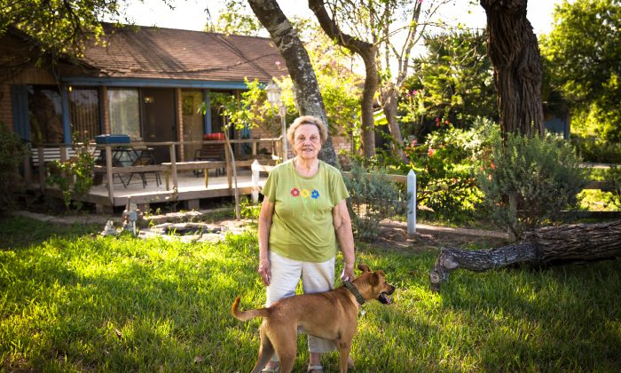 Pamela Taylor, who has lived in the same home since 1946, is in her yard in Brownsville, Texas, on June 1, 2017. (Benjamin Chasteen/The Epoch Times)