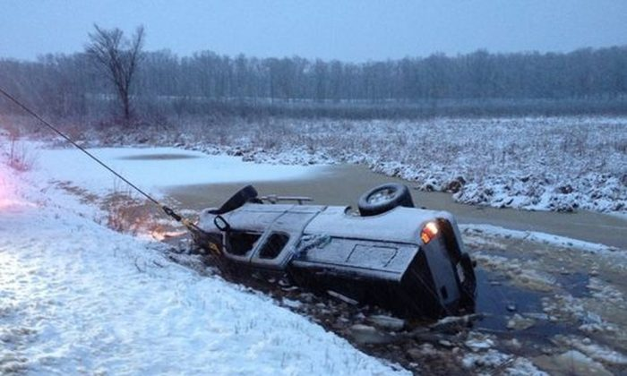 Three people were rescued after a pickup truck plunged into the icy Apple River. (Polk County Sheriff's Office)