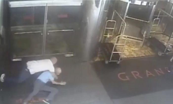 Ex-tennis star James Blake is shown tackled by a NYPD officer James Frascatore (L) in front of the Grand Hyatt hotel in New York on September 9, 2015 in this still image from a security camera video released on September 11, 2015. (Reuters/NYPD/Handout)