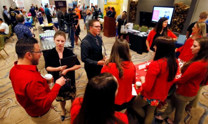 Target recruiters talk with job candidates Briana McShane (L) and Tanner Keyfauber (C) at a job fair in Golden, Colorado, June 7, 2017. (Reuters/Rick Wilking)