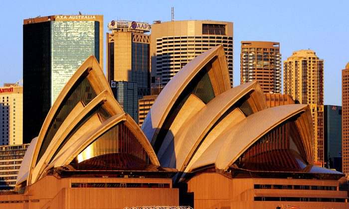 The Sydney Opera House in front of a city skyline. (GREG WOOD/AFP/Getty Images)