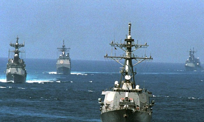 The USS John Paul Jones Leads A Formation Of Ships In A Series Of Close Ship Maneuvers Sept. 24, 2001 At Sea In Southwest Asia. (U.S. Navy/Getty Images)