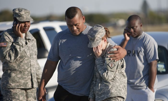 Sgt. Fanuaee Vea (L) embraces Pvt. Savannah Green after a shooting that took 13 lives in Fort Hood, Killeen, Texas, on Nov. 5, 2009. (Ben Sklar/Getty Images)