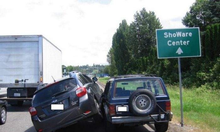 A Subaru Impreza is partially on top of a Jeep after ramming into it three time in Kent, Washington, on June 21, 2017. (Courtesy Washington State Patrol)