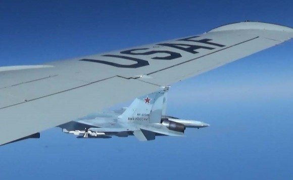 A U.S. RC-135U flying in international airspace over the Baltic Sea being intercepted intercepted by a Russian SU-27 Flanker June 19, 2017. (Courtesy photo/Released)