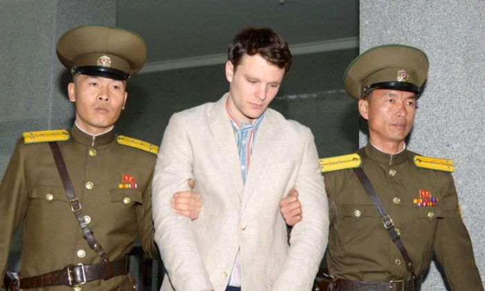 Otto Frederick Warmbier (C), a University of Virginia student who was detained in North Korea since early January, is taken to North Korea's top court in Pyongyang, North Korea, in this photo released by Kyodo on March 16, 2016. (Kyodo/Reuters)