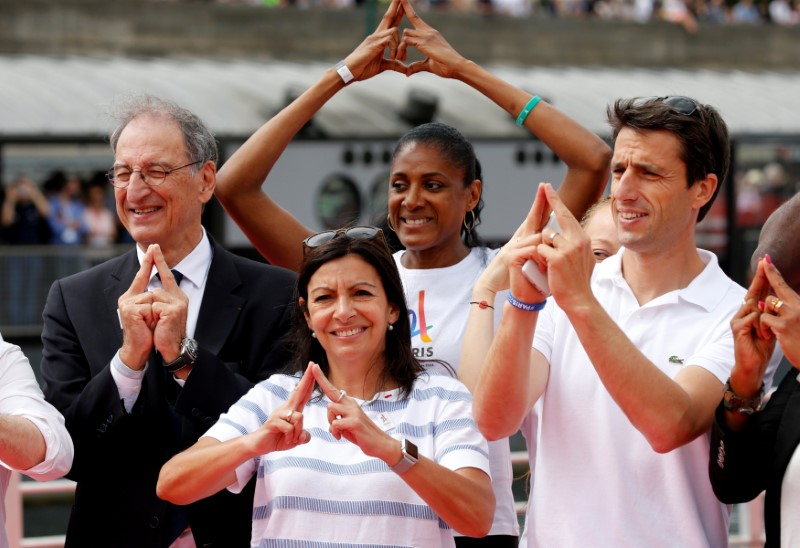 (L-R) President of the French National Olympic and Sports Committee (CNOSF) Denis Masseglia, Paris Mayor Anne Hidalgo, Olynpic champion Marie-Jose Perec, and Tony Estanguet, co-president of the Paris candicacy for the 2024 Olympics, pose on an athletics track installed on the River Seine in Paris, France, June 23, 2017 as Paris transforms into a giant Olympic park to celebrate International Olympic Days with a variety of sporting events for the public across the city during two days as the city bids to host the 2024 Olympic and Paralympic Games.  REUTERS/Jean-Paul Pelissier