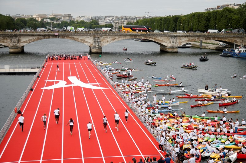 Runners compete on an athletics track that floats on the River Seine, in Paris, France on June 23, 2017.  (REUTERS/Charles Platiau)